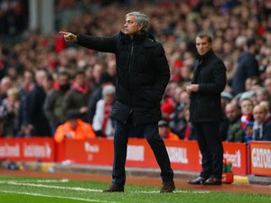 Jose Mourinho manager of Chelsea gives instruction during the Barclays Premier League match between Liverpool and Chelsea at Anfield on November 8, 2014