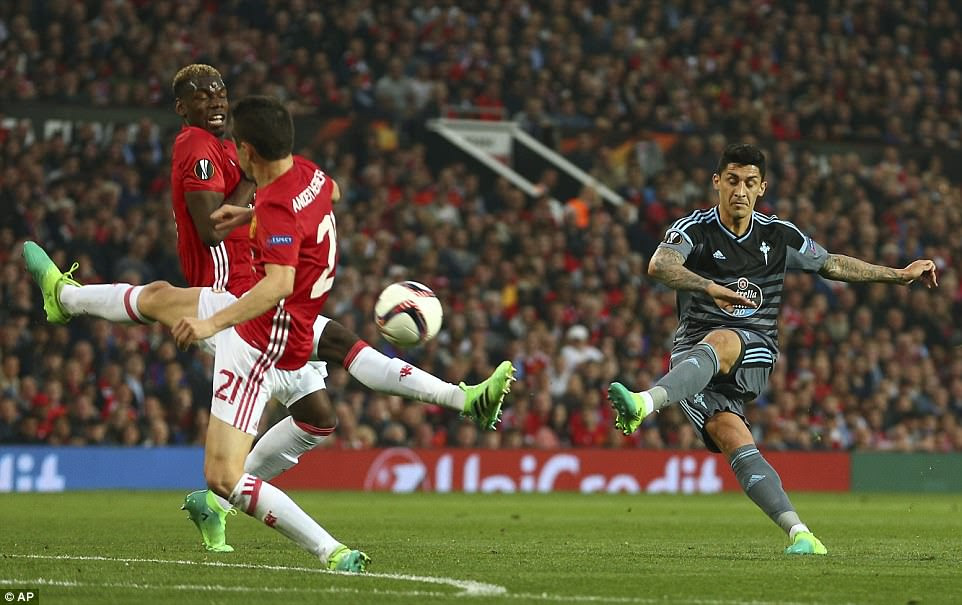Spanish midfielder Pablo Hernandez (right) unleashes a fierce shot from range which was tipped over by Romero