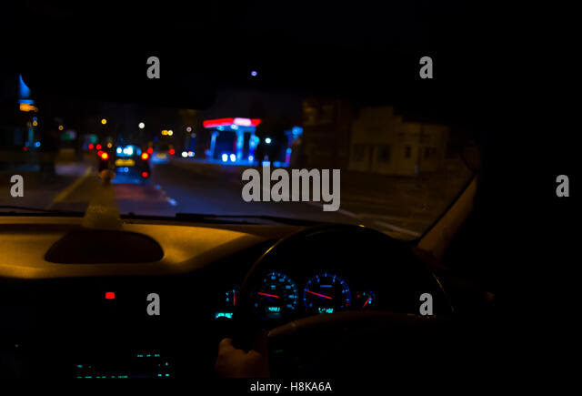 Motion blurred view of night driving through the city - Stock Image
