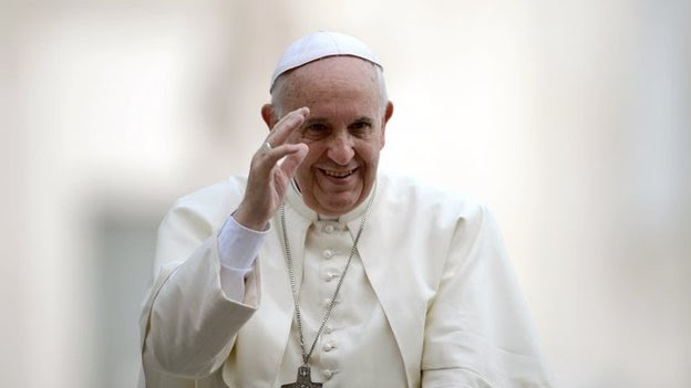 File photo: Pope Francis greets the crowd during his general audience at St Peter's square at the Vatican, 15 October 2014