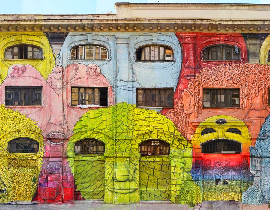 Blus Massive New Mural in Rome Turns 48 Windows into Faces street art Rome murals