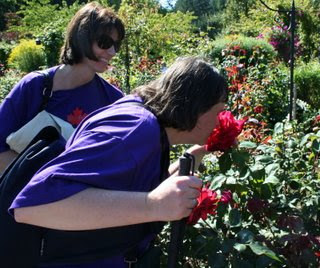 Ilona stops along the way to smell the roses in the Rose Garden