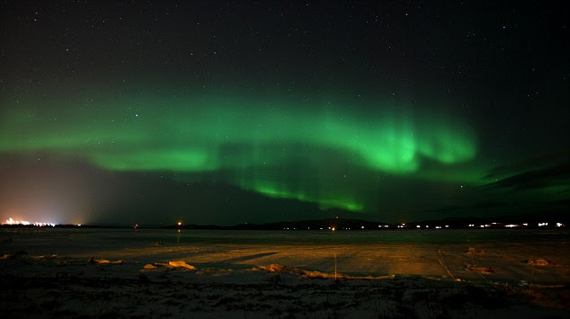 The Aurora Borealis, more commonly known as the Northern Lights, are seen near the town of Lakselv, at the mouth of the Porsanger Fjord, in Northern Norway