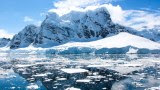 Snow-capped mountains touch the Southern Ocean