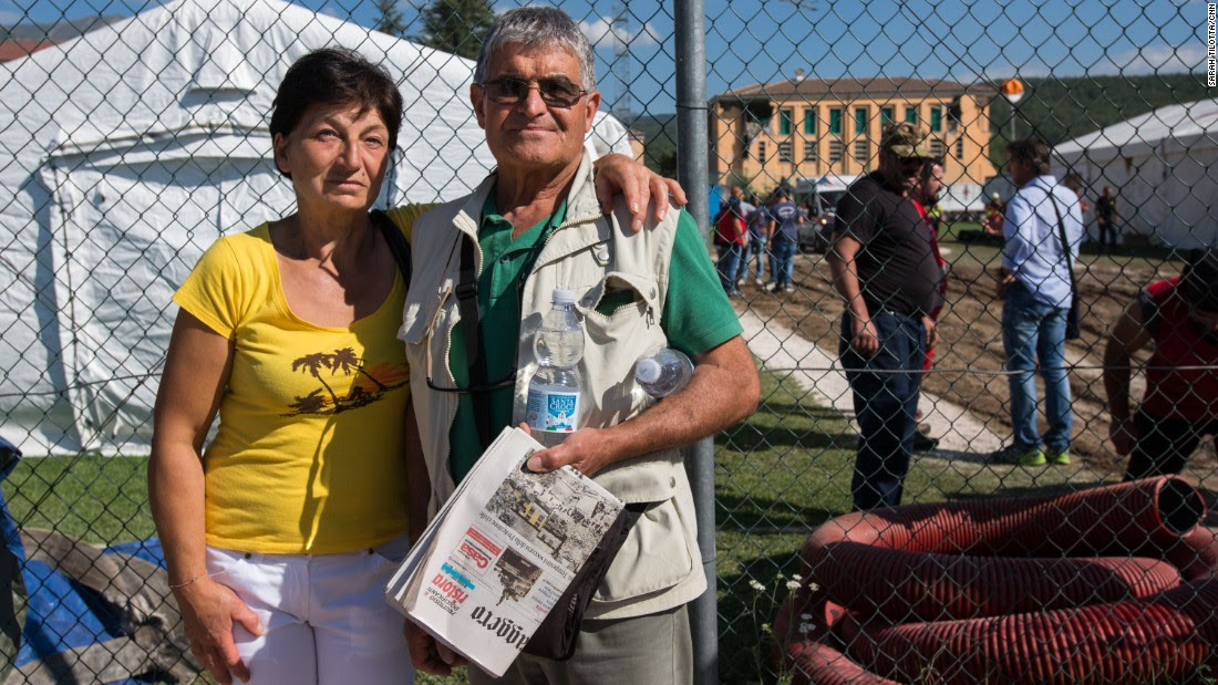 Marisa Di Tommaso and husband Michelo Giuseppe pose together near the makeshift headquarters of the Italian Red Cross in Amatrice.