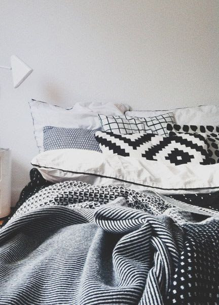 black and white textiles.. love the layered feeling to this bedding :)