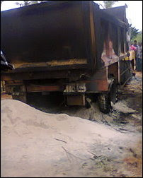 Vehicle involved in sand scooping burnt down by Puththoor villagers after the speeding vehicle hit