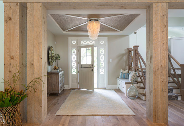 Coastal Foyer with Reclaimed beams and capiz chandelier. Troy Thies Photography.