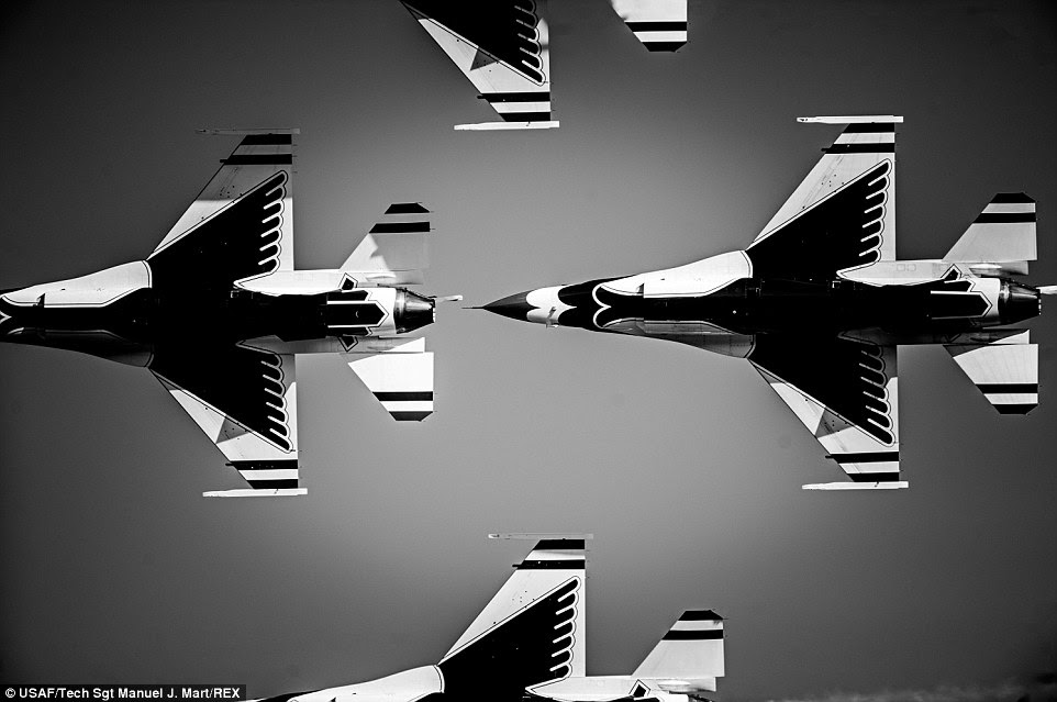 Display: Thunderbirds Diamond Formation pilots perform the Bottom Up Pass during the Wings Over North Georgia Air Show in Rome, Ga.