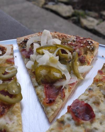 Pizza w/ Ham, red lentil puree, tomatillo salsa, pickled fennel, jalapeno