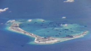 Chinese dredging vessels purportedly seen in the waters around Mischief Reef in the disputed Spratly Islands in the South China Sea in this still image from video taken by a US surveillance aircraft on 21 May 2015