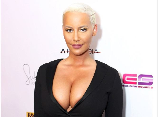 Amber Rose Rocks Smaller Boobs After Her Reduction Surgery (Photos)