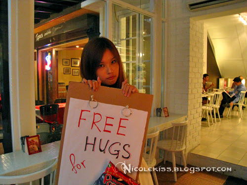 puppy eye nicole with free hugs sign