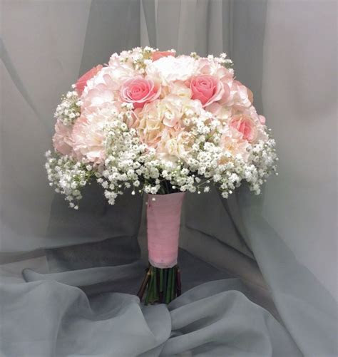Bridal bouquet with pink roses, pink hydrangea and pink