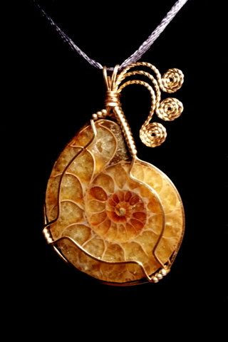 Ammonite Fossil Cabochon Handmade Wire Wrapped in Bronze Pendant. $69.95, via Etsy.