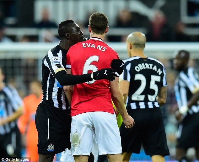 In trouble: In the run up to the wedding Cisse was banned after spitting at Manchester United defender Jonny Evans
