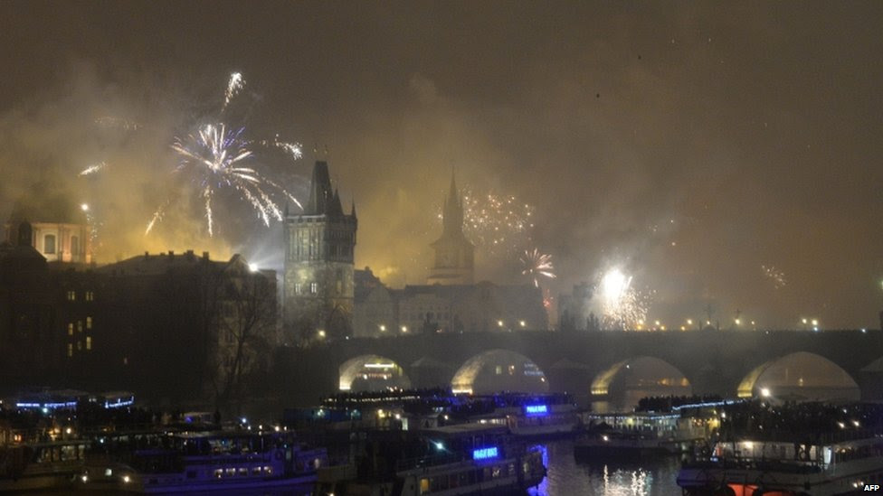 Fireworks explode above the Charles Bridge during the New Year celebrations in Prague (01 January 2015)