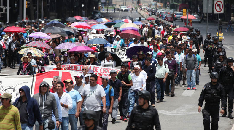 CNTE teachers march to join the sit-in against the neoliberal educational reforms of Enrique Peña Nieto.
