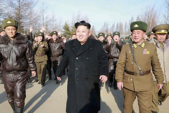 North Korean leader Kim Jong Un walks as he inspects the KPA Air and Anti-Air Force Unit 991, honoured with the title of O Jung Hup-led Seventh Regiment, in this undated photo released by North Korea's Korean Central News Agency (KCNA) in Pyongyang November 21, 2014. REUTERS/KCNA