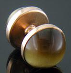 Sansbury & Nellis Tiger Eye cufflinks crafted in 14kt yellow gold. (J8847)