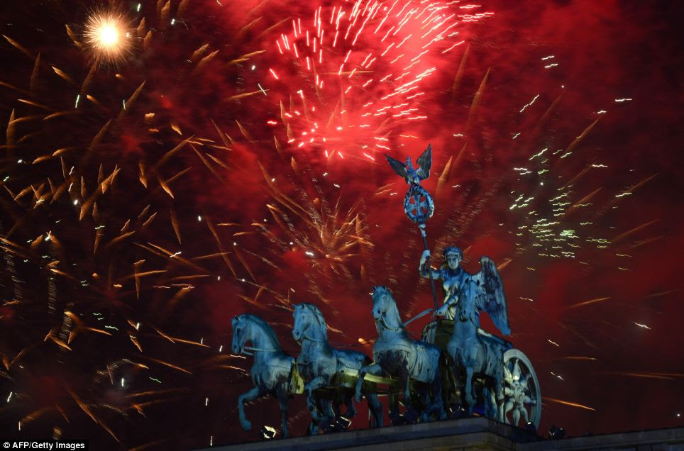 Fireworks explode over of Berlin's landmark the Brandenburg Gate, where one of the country's biggest New Year's parties was celebrated