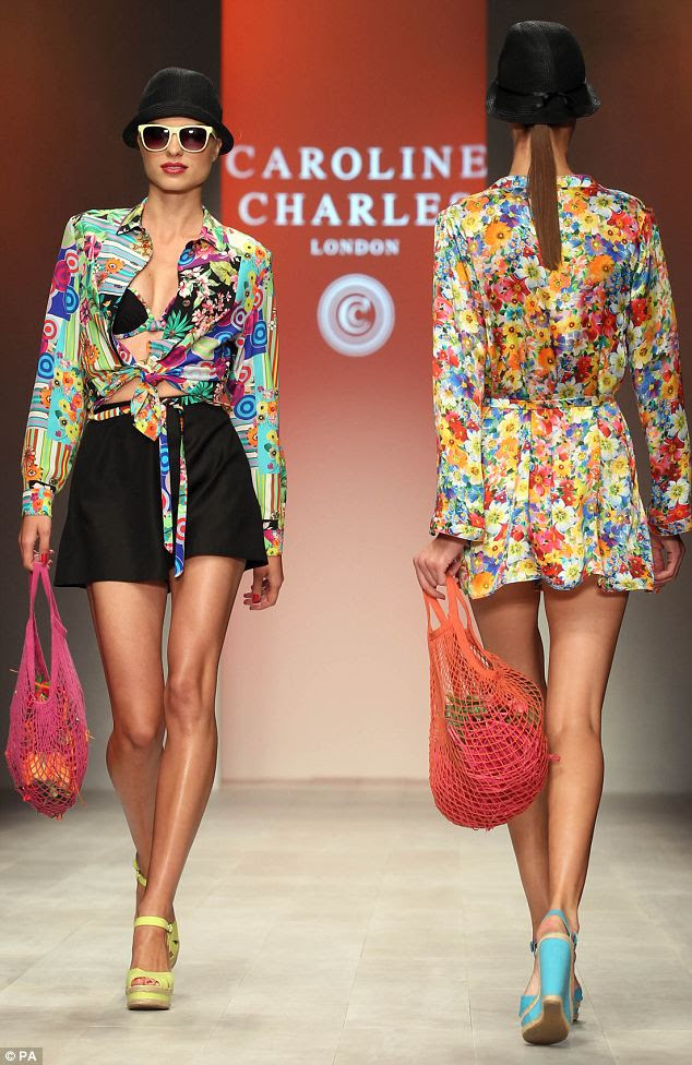 The front row needed those shades: Clashing prints and eighties accessories were key features of the Caroline Charles collection