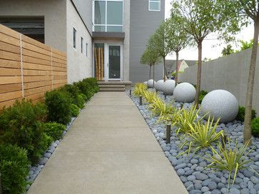 Contemporary Zen-like landscape installation giving this townhome's entrance quite the curb appeal wouldn't you say? To see more ideas like this visit http://bylands.com