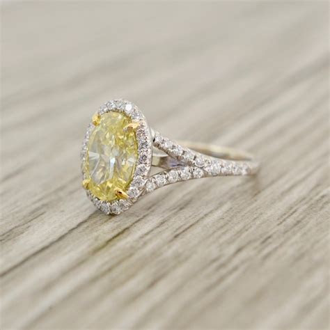 Fancy Yellow Oval Brilliant in a True French Pavé Halo
