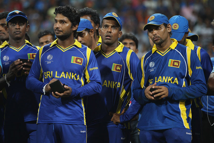 Disappointed Sri Lanka players watch their opponents life the trophy, India v Sri Lanka, final, World Cup 2011, Mumbai, April 2, 2011
