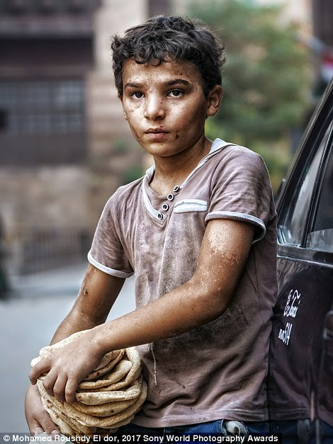 When photographer Mohamed Roushdy El dor took this portrait (left) in Cairo, Egypt, he asked the sad boy to smile but he said he couldn't
