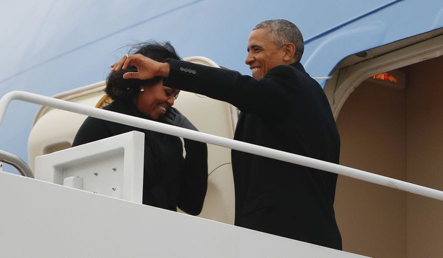 President Barack Obama and first lady Michelle Obama board Air Force One at Andrews Air Force Base, Md., Tuesday, Jan. 10, 2017. Obama is traveling to Chicago to deliver a farewell address, continuing a tradition established by the nation's first president more than two centuries ago. (AP Photo/Pablo Martinez Monsivais)