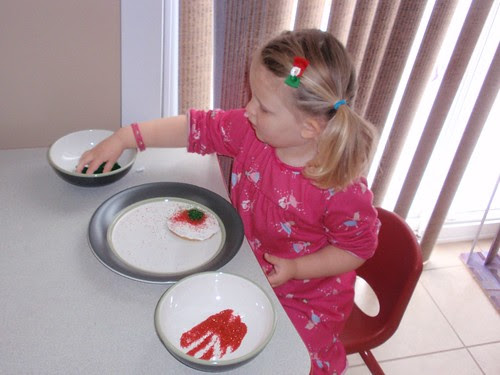 12.12.10 Libby decorating cookies