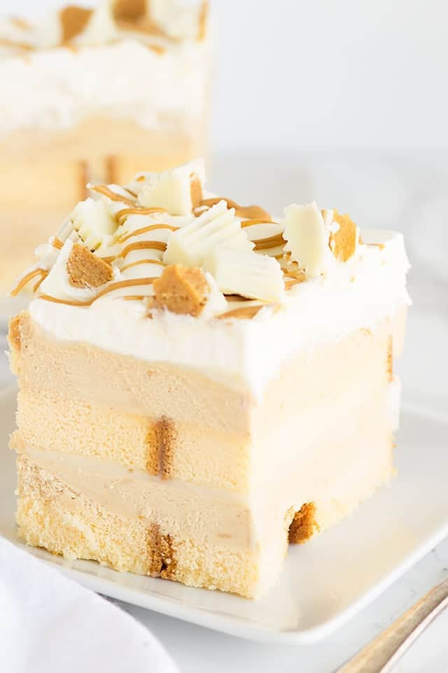 No Bake White Chocolate Peanut Butter Dessert - layers of buttery pound cake, peanut butter mousse, white chocolate ganache and topped with white chocolate peanut butter cups! This is the perfect summer treat !