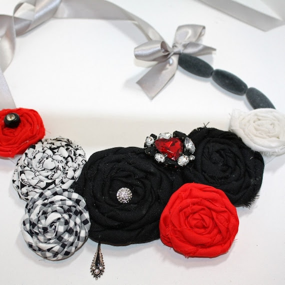 Classic elegance red, white, and black fabric rosette bib necklace