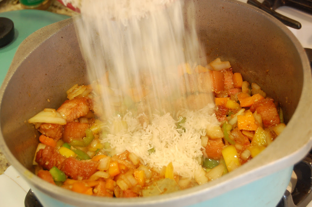 Adding Rice for Cuban Congri Recipe