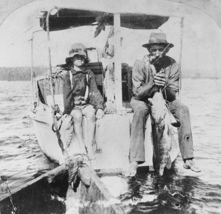 Sandy Straits Fisherman, ca 1920. Australian publid domain image.