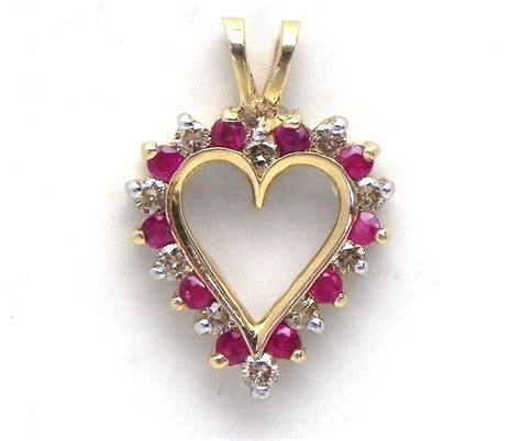 Ladies Yellow Gold Diamond & Ruby Open Heart Pendant