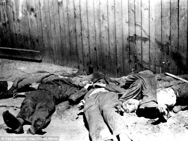 Deceased: A group of bloodied Jewish victims lie did after a night of violence at a pogrom in Lviv