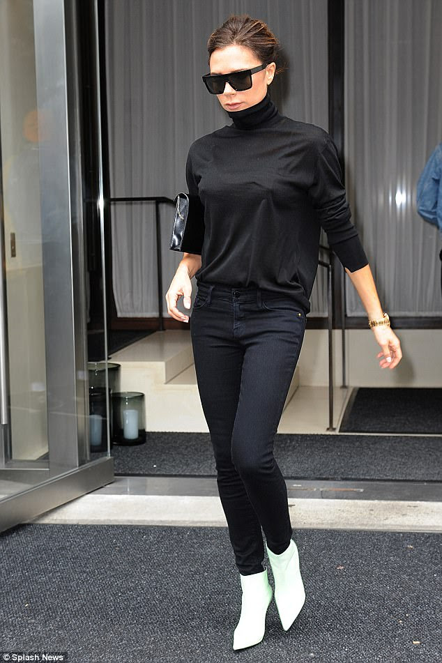 Stylish: Sticking to a chic monochrome look, the mum-of-four completed her look with skintight black jeans and a patent clutch