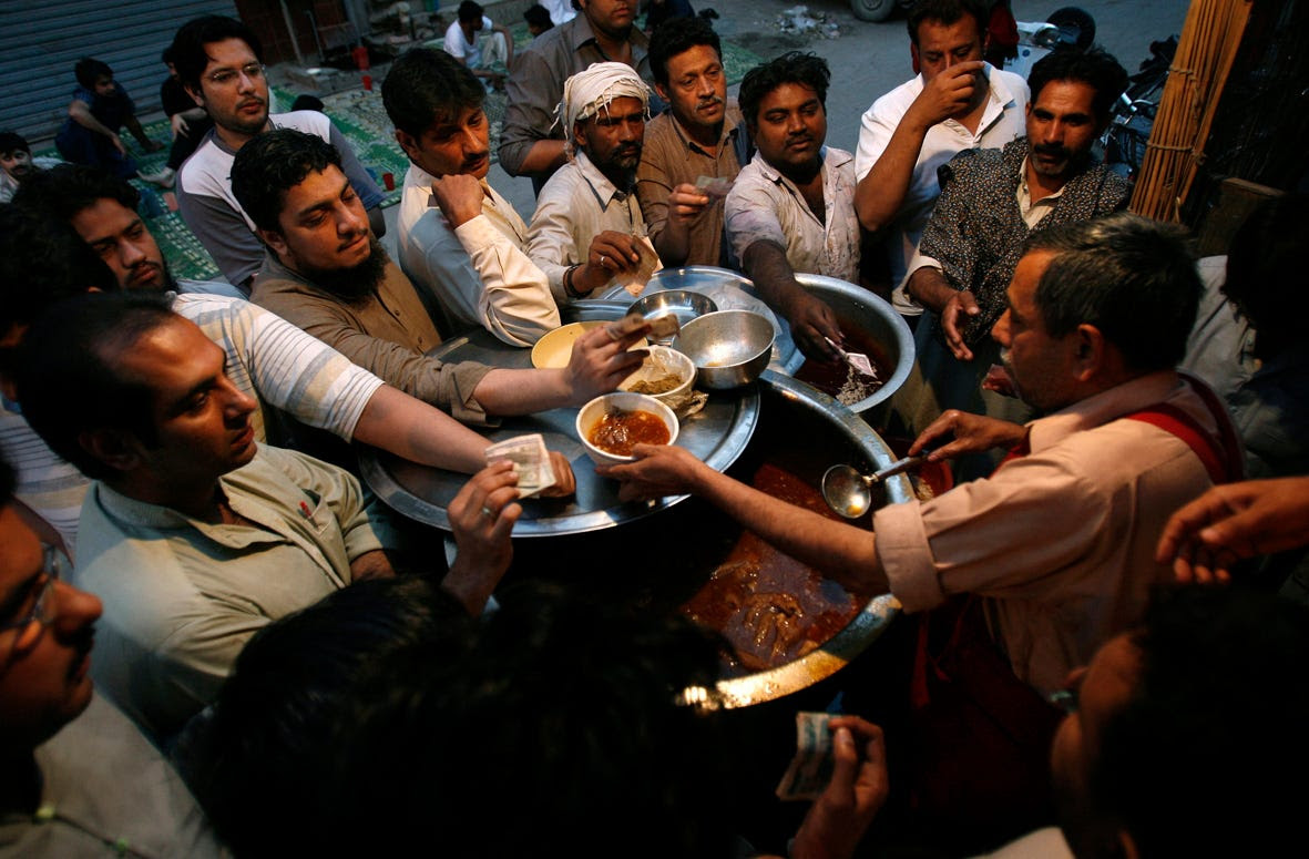 In Lahore, Pakistan, men line up for Siri Paya, a traditional breakfast dish made of goat heads and feet.