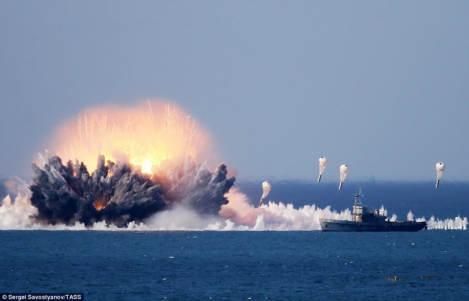 The drills involved 12,500 troops, alongside fighter jets and anti-aircraft missiles, and took place at the Opuk training range on the Black Sea coast. Pictured is another view of the thermobaric bomb blast