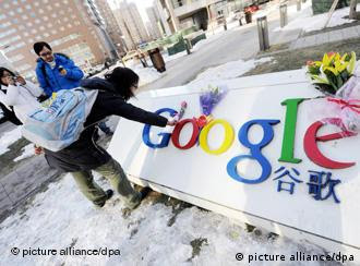 A young Chinese woman lays flowers on the logo of Google in front of the headquarters of Google China in Beijing, China, 13 January 2010. Googles threat to quit China over censorship and hacking intensified Sino-U.S. frictions on Wednesday (13 January 2010) as Washington said it had serious concerns and demanded an explanation from Beijing. China has not made any significant comment since Google, the worlds top search engine, said it would not abide by censorship and may shut its Chinese-language google.cn website because of attacks from China on human rights activists using its Gmail service and on dozens of companies. U.S. Commerce Secretary Gary Locke urged China to work with Google and other firms to ensure cyber security, calling the intrusion troubling to the U.S. government and American companies doing business in China