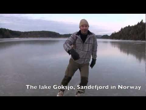 video de un hombre en un lago helado noruego bebiendo y patinando
