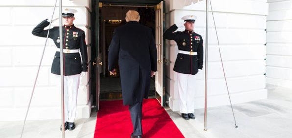 Flanked by the Marine Sentries, President Donald Trump walks into the White House (Photo: White House/Facebook)