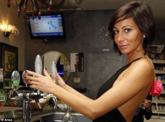 Causing controversy: Laura Maggi, 34, who runs a bar called Le Cafe, has dominated newspapers and TV chat shows, after pictures of her dressed in barely anything appeared on the internet