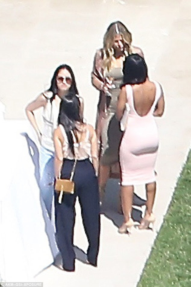 BFFs: Malika was seen chatting away to Khloe in her form-fitting bodycon dress