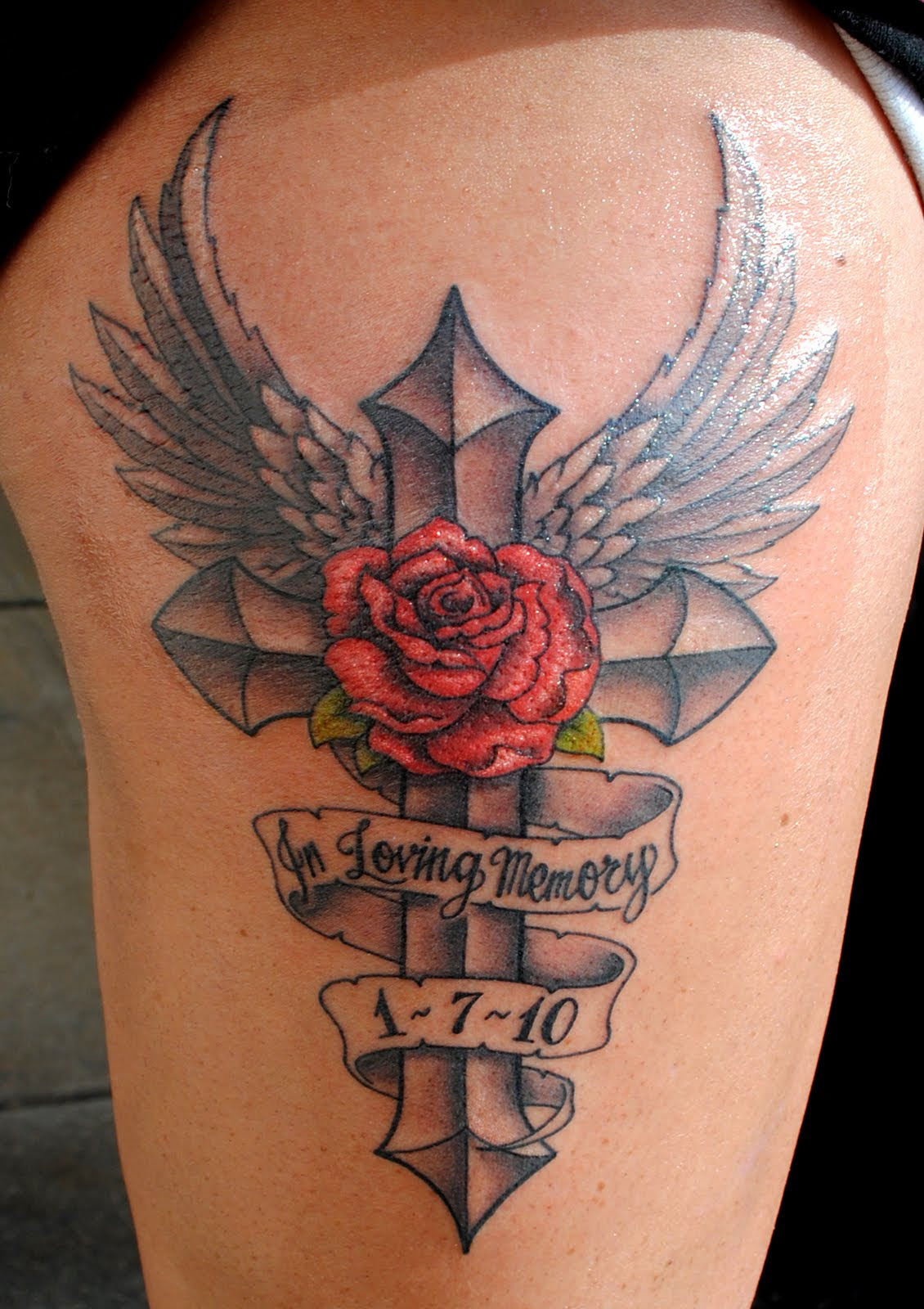 Rose Flower And Winged Cross Tattoo On Thigh