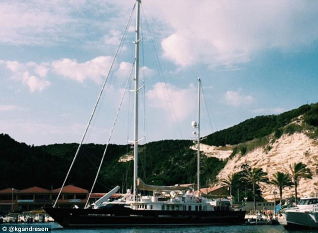 All aboard: A large yacht floats in a bay surrounded by green hills and palm trees, in just one snapshot from Katharina's many holidays