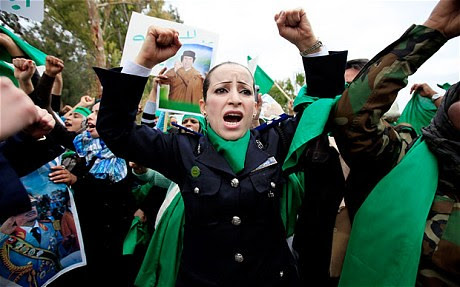 Libyans demonstrating against western imperialist attacks on their North African state. The U.S., France, Canada and Britain have launched a joint offensive aimed at toppling the government led by Muammar Gaddafi. by Pan-African News Wire File Photos