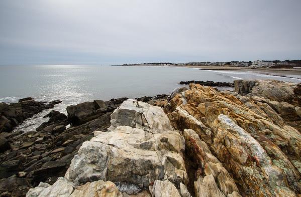 a rocky coastline, shimmering water